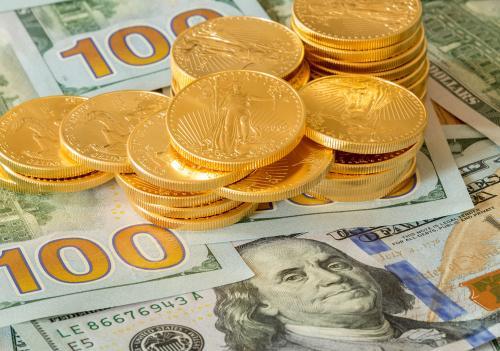美元日线借力上升 黄金期货承压震荡